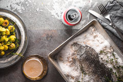 Fish baked in salt with Brussels sprouts  and beer on the stone background top view. Horizontal Royalty Free Stock Photo