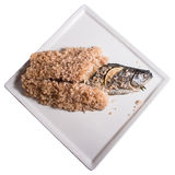 Fish Baked in Salt Crust. On square plate Stock Image