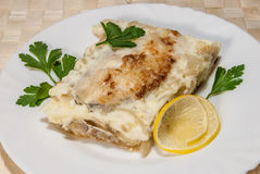 Fish baked under cheese Stock Photo
