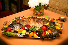 Fish baked Stock Images