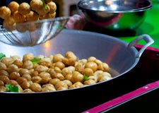 Fish Ball in a frying pan with hot oil. in Thailand street food royalty free stock image