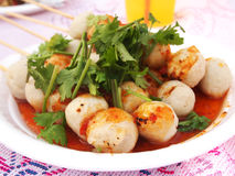 Fish ball grilled. Produce snacks such as fresh fish grilled on the stove and bread topped with spicy sauce Royalty Free Stock Photos