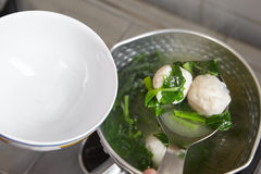 Fish ball soup. Making fish ball soup with green vegetable Royalty Free Stock Photo
