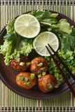 Fish balls in curry sauce with lime top view vertical Royalty Free Stock Photos