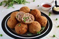 Fish balls with tuna and green peas Stock Photo