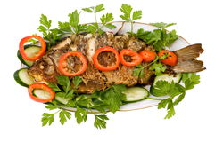 Fish Barbecue. Grilled fish and vegetables. prepared fish, the culinary specialist, kitchen(cuisine), meal Royalty Free Stock Images