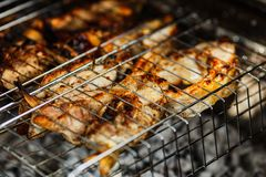 Fish barbecue, the process of cooking fish on the grill. Picnic food royalty free stock photos