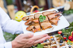Fish.Barbecue smoked fish on catering Royalty Free Stock Images