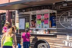 Fish Basket mobile fish bar food truck. Fish Basket food truck serving fish tacos to customers in Seattle Washington Stock Photo