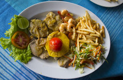 Fish and beеr. Fish with vegetables and salad Royalty Free Stock Image