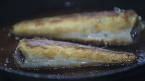 Fish Is Being Fried On The Frying Pan stock footage