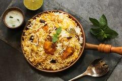 Fish Biryani with Raita. Indian food on dark background basmati rice royalty free stock images