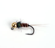 Fish bite. Hand made fly for fly fishing Stock Photos
