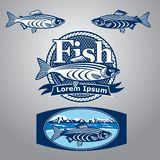 Fish. Blue fish sign and labels Royalty Free Stock Image