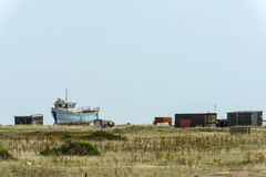 Fish boat aground and sheds at Dungedness Stock Photos