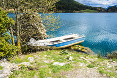 Fish Boat at Blue Lake in the mountains Stock Image