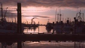 Fish Boat Morning Departure 4K UHD. A shrimp boat departs Steveston Harbor on the Fraser River in British Columbia, Canada at sunrise. 4K. UHD stock footage