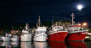 Fish boats. Fishing boats in harbor at the moonlight with free space for text Stock Photography