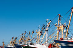 Fish boats. Fish trawlers against blu sky Royalty Free Stock Photography