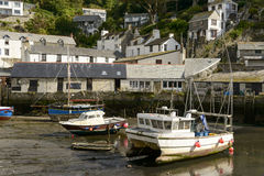Fish-boats aground at harbour, Polperro Stock Images