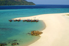 Fish boats on a sandy beach of tropical island Royalty Free Stock Photography