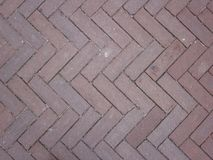 Fish bone or herring bone pattern of the pavement. A fish bone or herring bone pattern of the pavement royalty free stock image