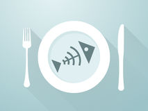 Fish bones on a plate. With cutlery Stock Image