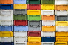 Fish boxes. Stacked returnable boxes of fish in varius colors stock photo