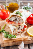 Fish in bread, in a pita. Turkish cuisine Royalty Free Stock Images
