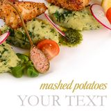 Fish in breadcrumbs with mashed potatoes Royalty Free Stock Images