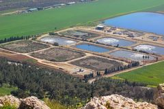 Fish breeding ponds in the Jezreel Valley, Lower Galilee, Israel. Views of the Jezreel Valley and fish breeding ponds from the heights of Mount Precipice stock image