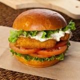 Fish burger. Breaded Fish burger. Selective focus Stock Photography
