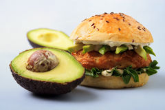Fish burger. With brioche bun , mayonnaise and avocado Stock Photo