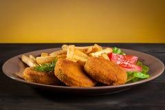Fish burger  and chips Royalty Free Stock Photos