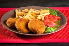 Fish burger  and chips Royalty Free Stock Photography