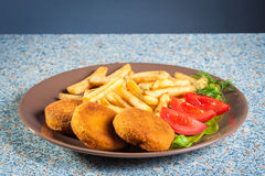 Fish burger  and chips Stock Images