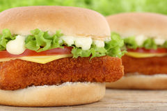 Fish burger fishburger hamburger closeup close up tomatoes lettuce cheese royalty free stock images