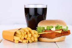 Fish burger fishburger hamburger and fries menu meal combo cola. Drink unhealthy eating food Stock Photos