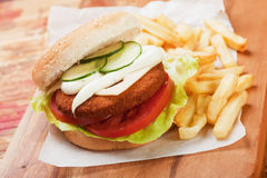 Fish burger with french fries Stock Images
