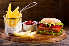 Fish burger with french fries stock photography