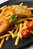 Fish Burger with fried chips on a pan Royalty Free Stock Photography