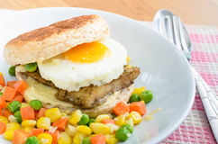 Fish Burger with fried eeg serving boiled mix vegetable Royalty Free Stock Photography