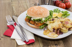 Fish Burger with fried Potatoes Royalty Free Stock Image