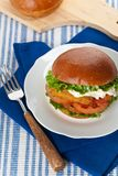 Fish burger. Homemade Breaded Fish burger. Selective focus Royalty Free Stock Photos