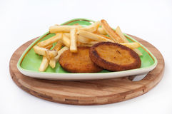 Fish burgers served with french fries on a plate Stock Photos