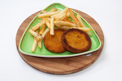 Fish burgers served with french fries on a plate Royalty Free Stock Images