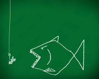 Fish business. Hook the fish business. on a blackboard Royalty Free Stock Images
