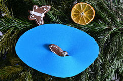Fish, butterfly and sun. Fish in the blue pond and butterfly made of gingerbread and sun made of orange on the green branch stock photo