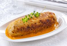 Fish cake served on a platter. Big tuna fish cake in sauce stock image