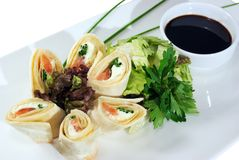 Fish in cake rolls and soy sauce isolated Royalty Free Stock Photos